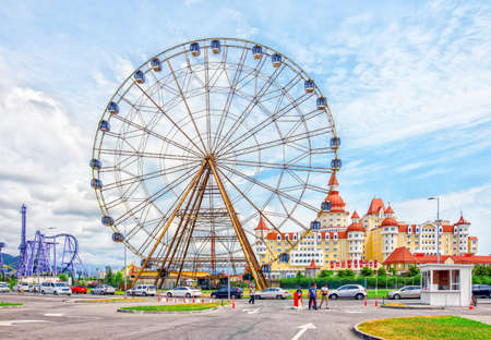 Sochi, Russia - June 21, 2019: Ferris wheel and children city in amusement park Sochi Park. Redactioneel