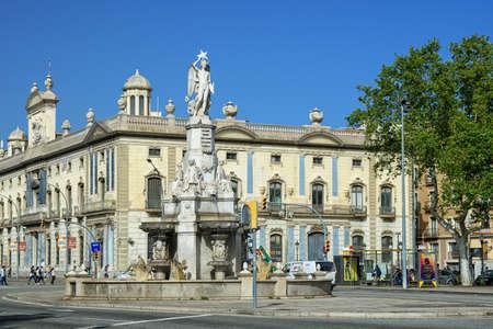 Barcelona, Spain - April 24, 2018: Pla de Palau, Font del Geni Catala monument in the center