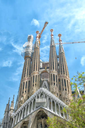 Barcelona, Spain - April 25, 2018: Famous architecture Antonio Gaudi masterpiece - basilica and temple Sagrada Familia Holy family in process of building