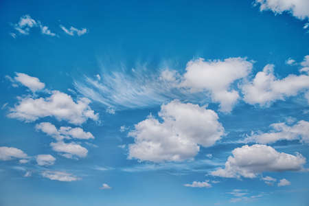 The bright blue cloudy sky in the summer midday