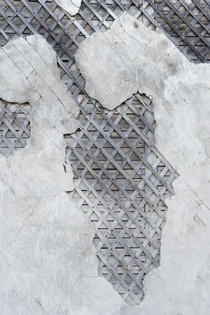 Old wooden walls with plaster crossed base. Old wooden structures with rusty nails. Wooden house wall vintage designs. Beams with a crate of thin strips. Vertical view /