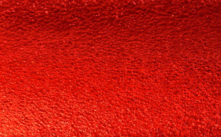 Red plastic foam and bubbles background Stockfoto