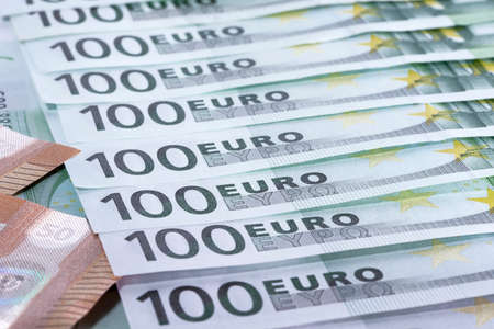 Heap of green houndred euro banknotes laying on each other Stockfoto