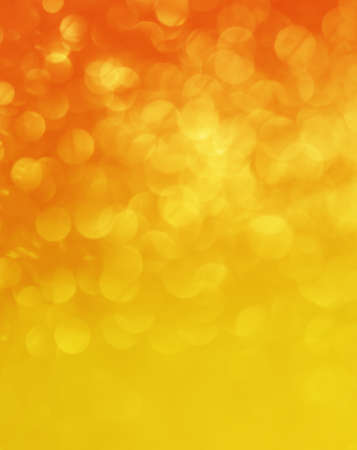 Orange gradient christmas festive elegant abstract background with bokeh lights, vertical