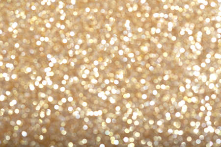 Smooth texture of golden glitter dust surface, luxury background Reklamní fotografie
