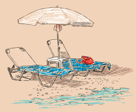 Beach umbrella and the sunbeds on the seashore