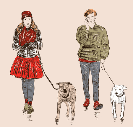 striding: The young people with their pets on a stroll