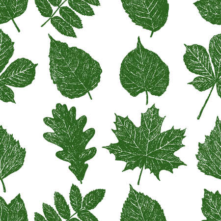 Seamless pattern of set silhouettes leaves of various deciduous trees