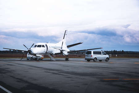 Airplane at the apron with passenger van