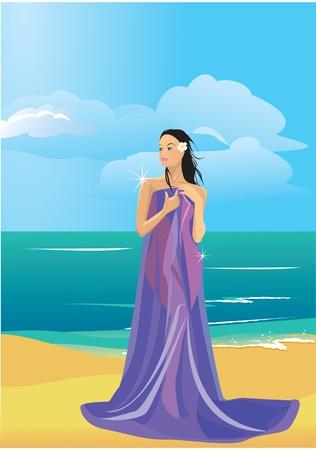 Belle femme nue enveloppée dans une serviette sur la plage
