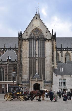 dam square:  a cathedral in amsterdam Dam square Editorial