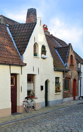 European small street with old brick houses Stock Photo - 12200851
