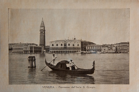 ITALY - CIRCA 1910: A picture printed in Italy shows image of Venice panoramic view with gondola boat, Vintage postcards 'Italy' series, circa 1910