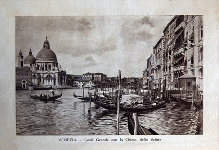 ITALY - CIRCA 1910: A picture printed in Italy shows image of Grand Canal con la Chiesa della Salute in Venice, Vintage postcards Italy series, circa 1910
