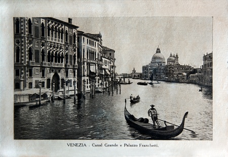 ITALY - CIRCA 1910: A picture printed in Italy shows image of Venice view Ponte di Rialto with gondola boat, Vintage postcards Italy series, circa 1910