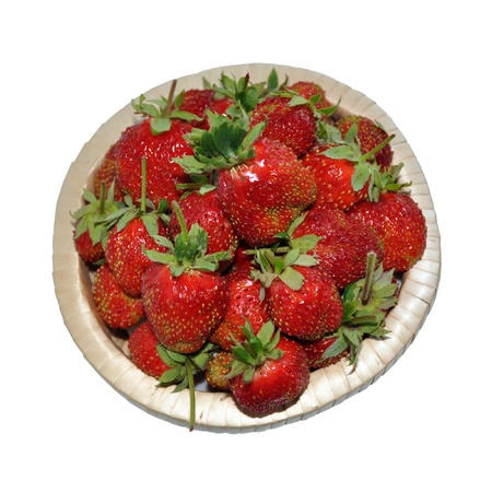 Appetizing strawberries in a basket. Isolated on a white background Stock Photo - 14629266