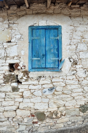 Old Wooden window with shutters painted blue color photo