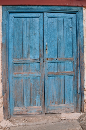 Old Wooden Door painted blue color photo