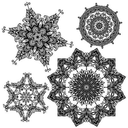 background kaleidoscope: Set of 4 black color round ornaments isolated on white background, kaleidoscope floral patterns in indian style. Mandala.