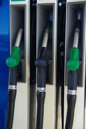unleaded: gas pump nozzles, gas station