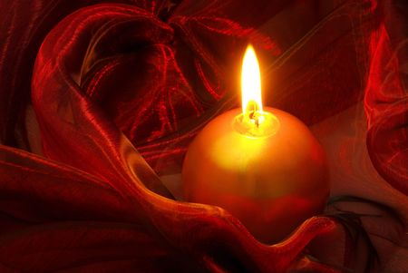 candle on red  photo