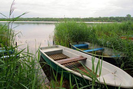green boat: rowboat