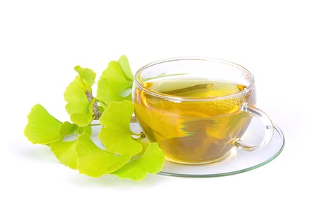 gingko leaves and tea isolated on white photo