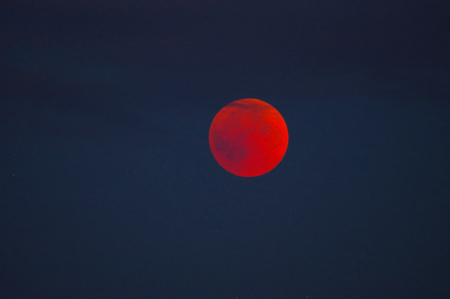 total lunar eclipse with red shining moon