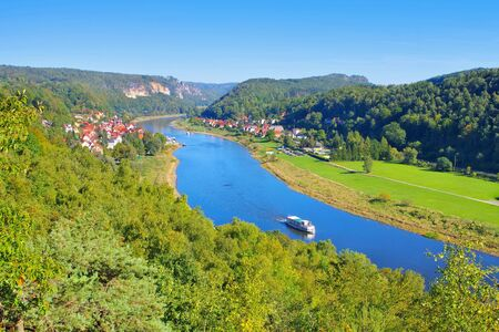 Elbe sandstone mountains, river Elbe and ship with town Wehlen
