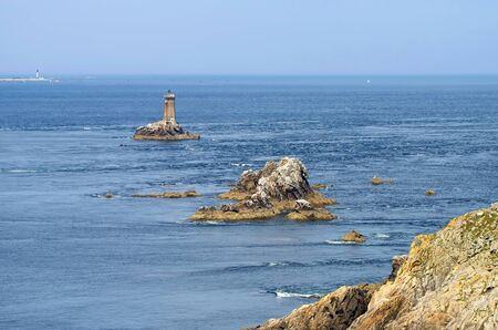 Pointe du Raz and lighthouse Phare de la Vieille in Brittany, France 写真素材