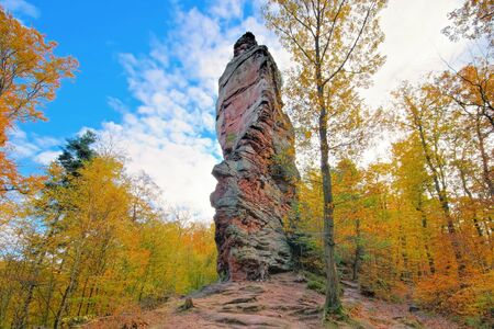 the rock Bindesbacher tower in Palatinate Forest in autumn, Germany