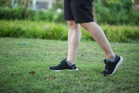 Man running on the grass 版權商用圖片