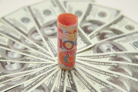 US dollar with renminbi banknote