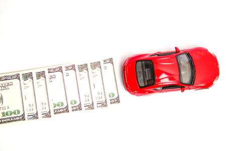 Car model and currency on background Imagens