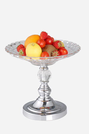 Glass fruit bowl with fruit