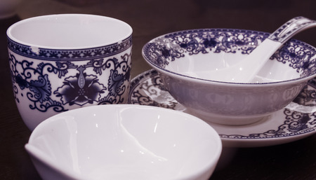 Table top with blue and white tableware Stock Photo