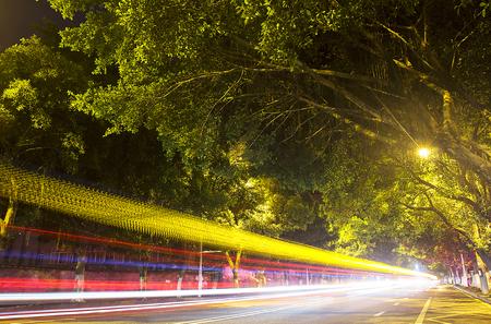 Urban traffic light trail at night