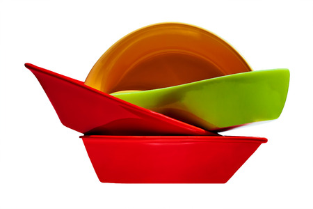 Stack of multicolored ceramic dishes  on white background  Standard-Bild
