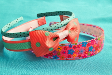 alice band:  childrens colored head bands on a blue background