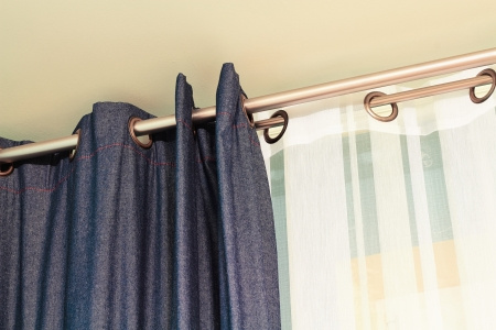 curtain: Denim  and white  curtains  with ring-top rail