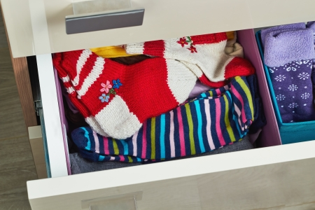 open dresser  drawer with different socks