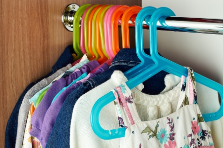 wardrobe with baby сlothes on  hangers
