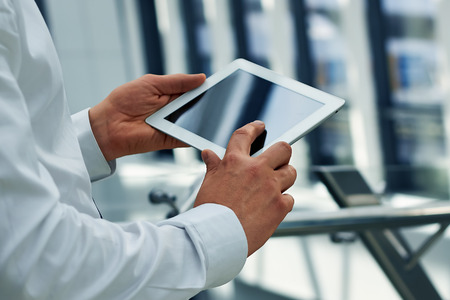 Businessman holding a  digital tablet photo