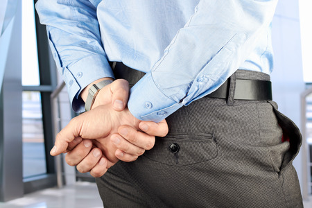 meditation help: businessman  standing  with  hands behind his back.