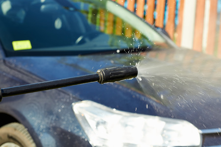 manual car washing cleaning with   water  photo