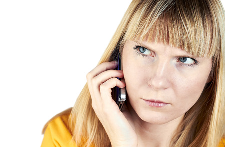 beautiful angry girl talking on  her smart phone