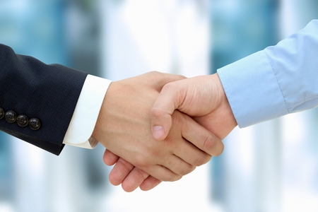 Close-up image of a firm handshake  between two colleagues in office  Stock fotó