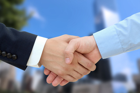 Close-up image of a firm handshake  between two colleagues isolated on a white background 版權商用圖片