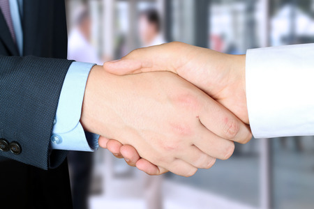 Close-up image of a firm handshake  between two colleagues outside Stock Photo