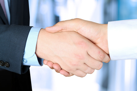 Close-up image of a firm handshake  between two colleagues outside photo